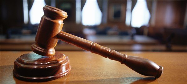 Footballer remanded for robbing church members during an all night service at gun point